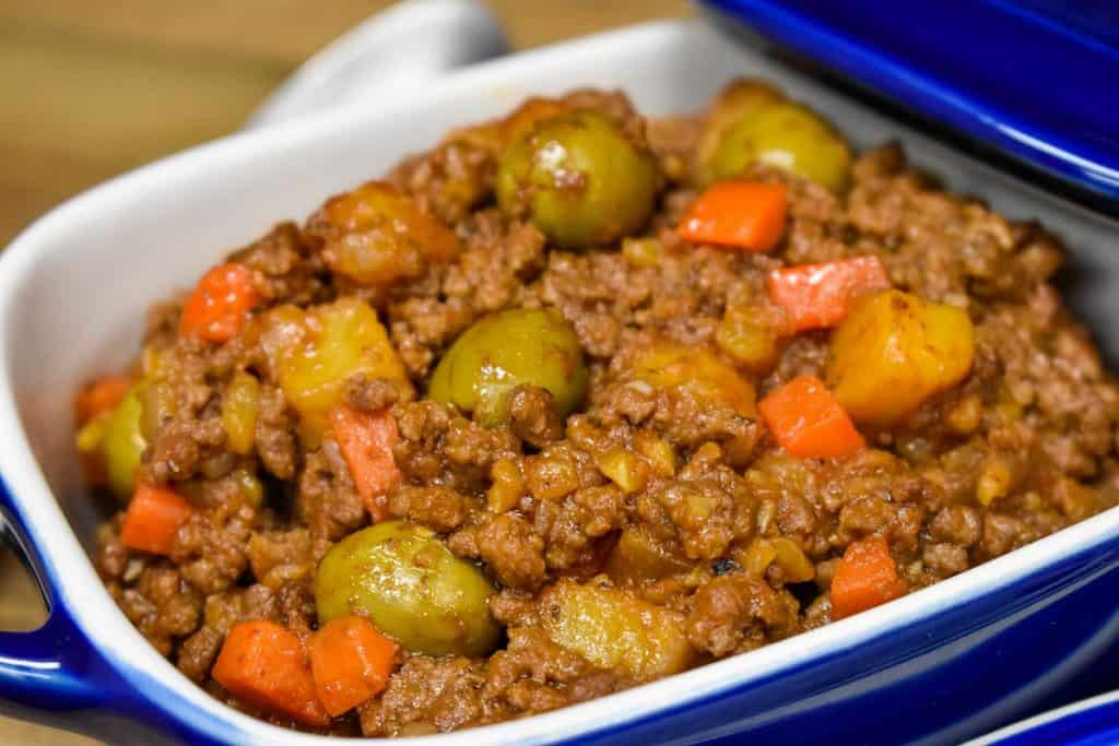 Picadillo served in a blue crock.