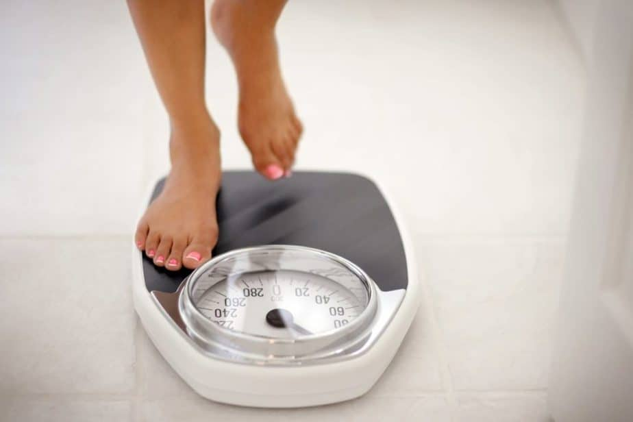 A woman weighs after working out