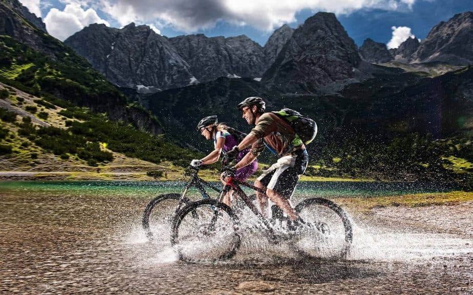 A biking couple is having a workout in the nature