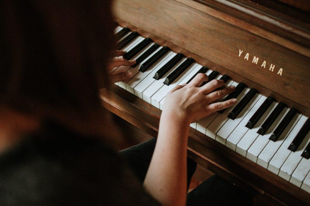 Women playing Piano