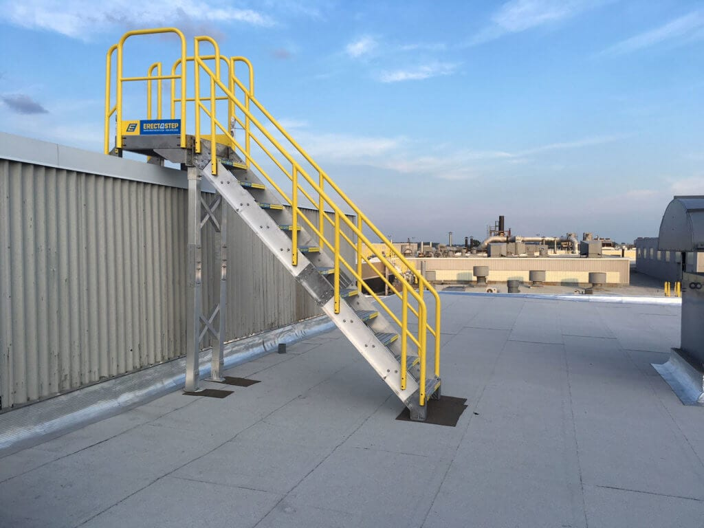 Side View of Roof Access Metal Stairs With Aluminum Handrails on Rooftop