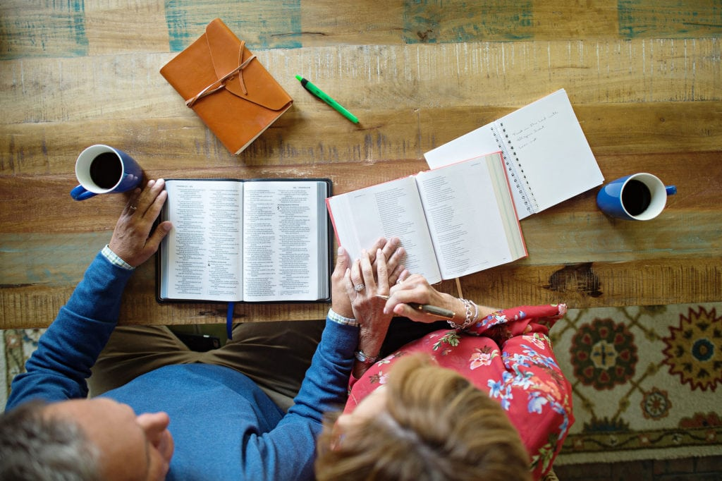 a couple read the Bible together