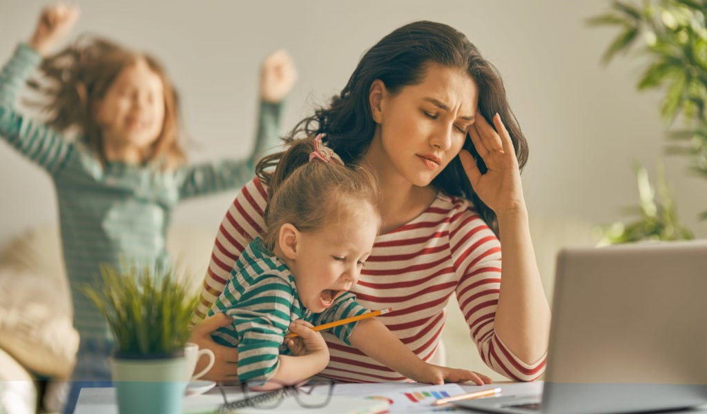 Mom working at home with kids
