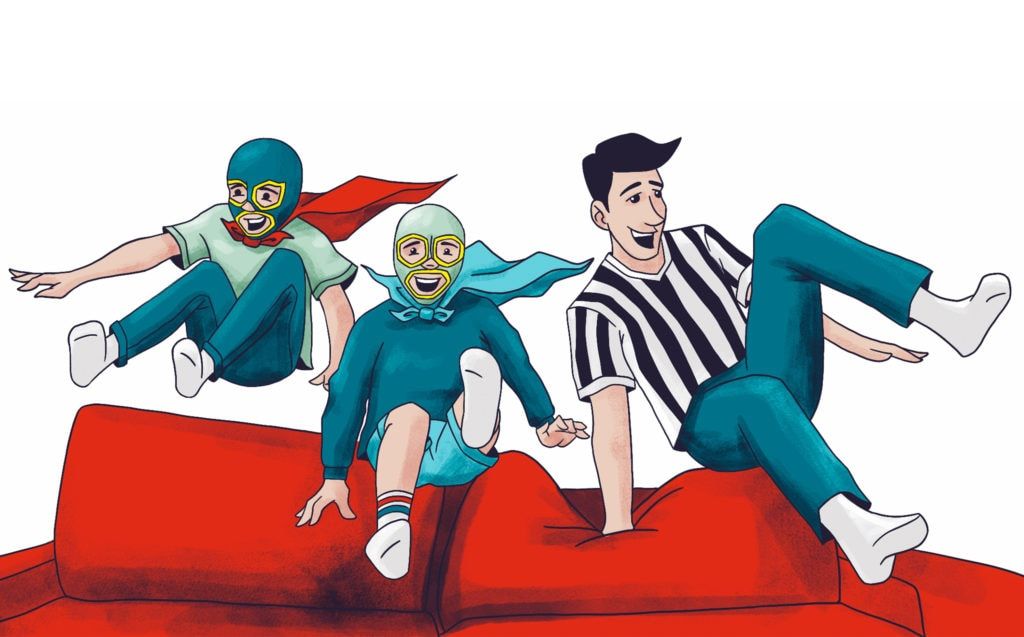 Siblings in luchador costumes jumping over a couch with their father dressed as a referee.