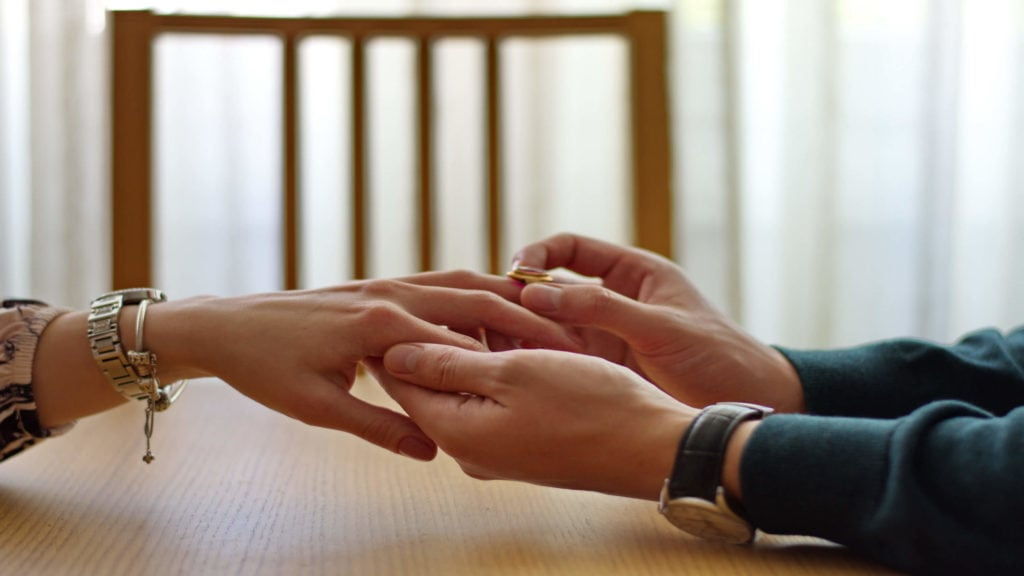 A man gives a woman an engagement ring