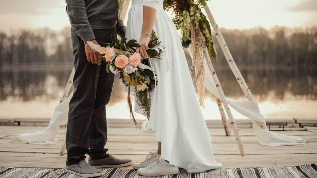 couple just married holding hands representing future marriage