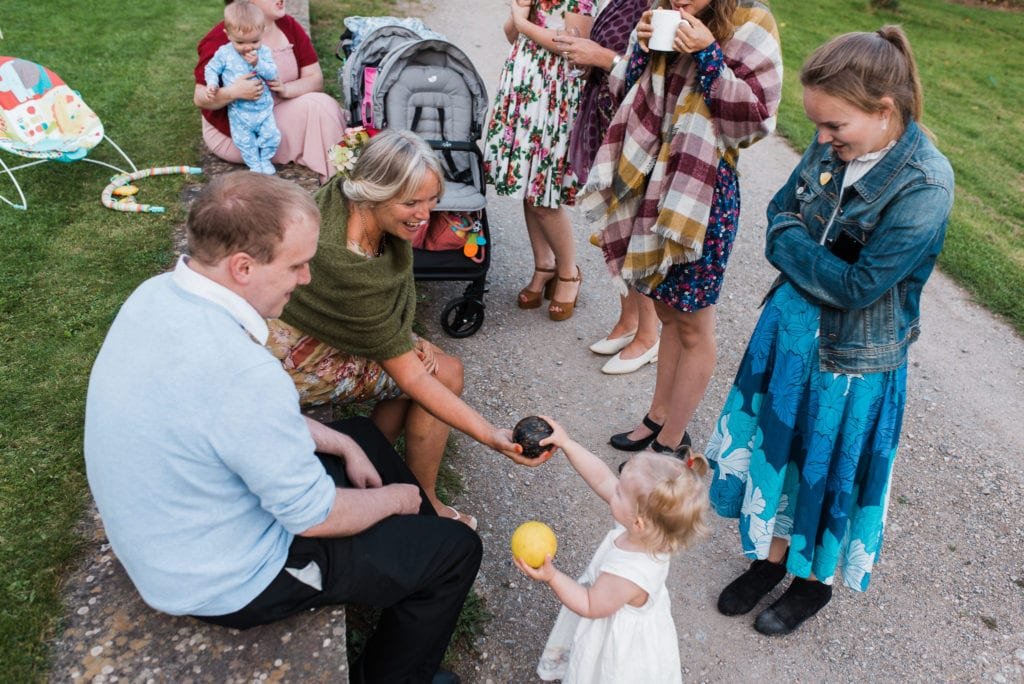 Kids at wedding play with the adults outdoor games