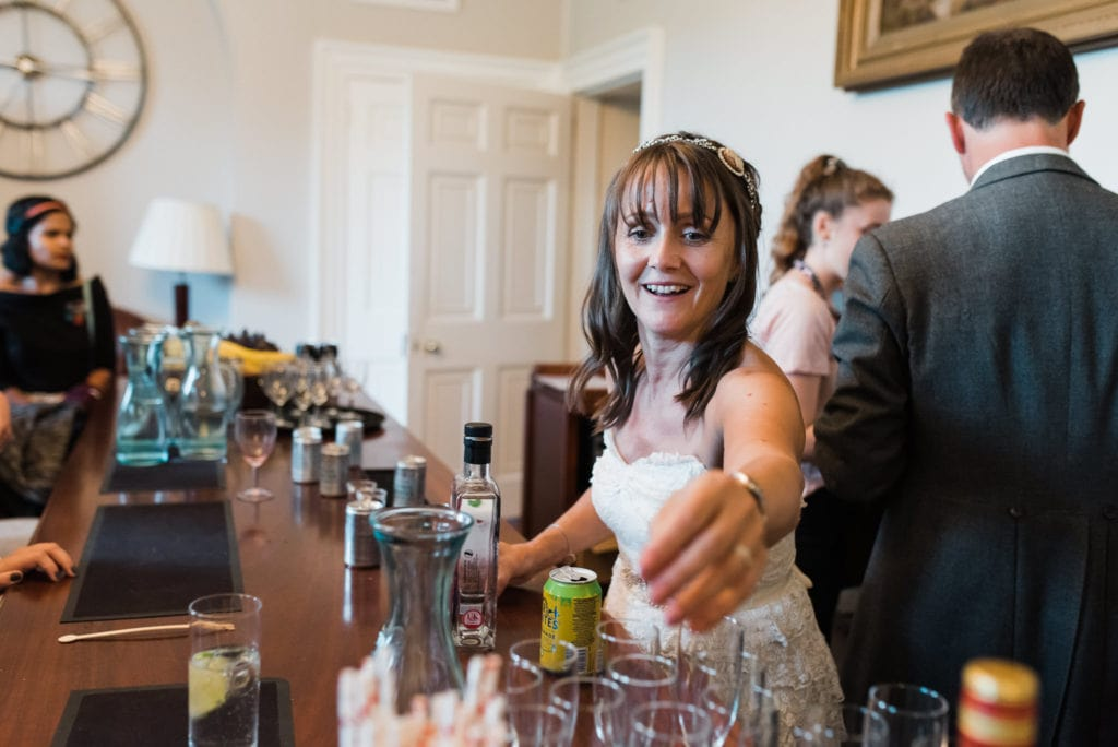 Bride serves the drinks from the gin bar