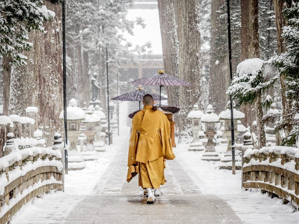 Monks walking to Torodo Hall, Okunoin cemetery, Koyasan