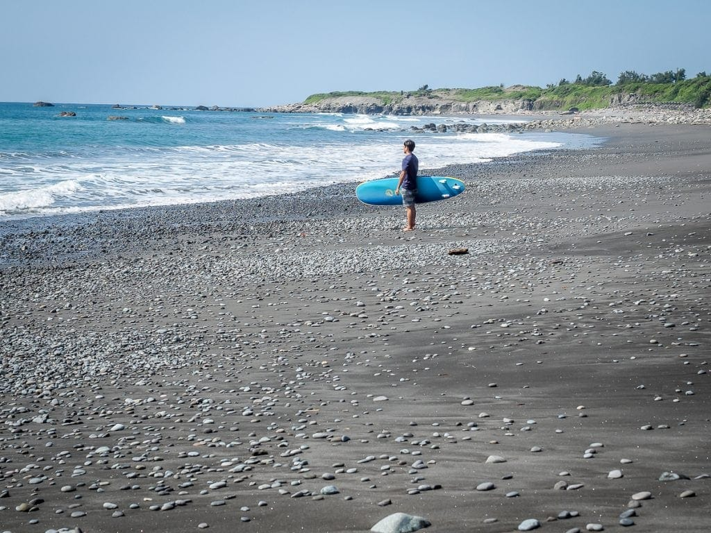 A surfer on Dulan beach in Taitung in winter