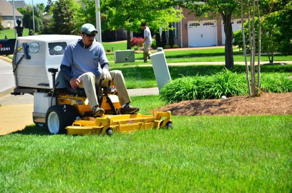 riding lawn mower over green field new clients
