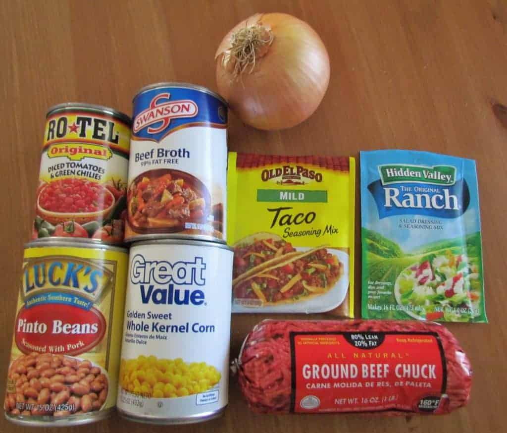 ground beef, taco seasoning, ranch seasoning, beef broth, pinto beans, corn, rotel, onion