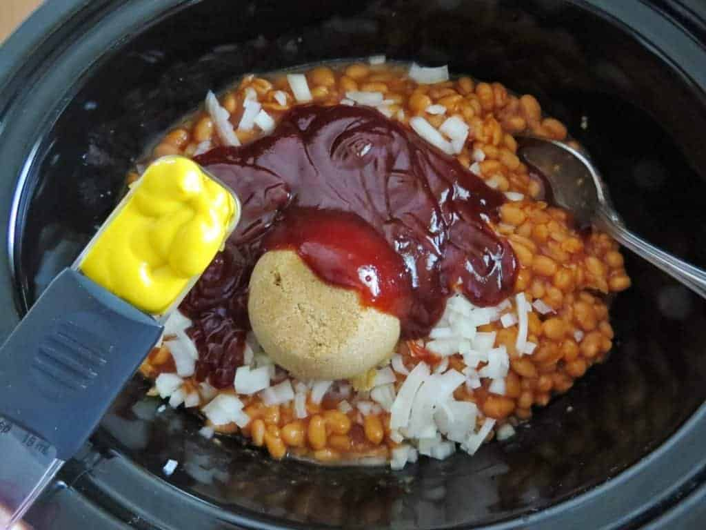 mustard added to slow cooker baked beans