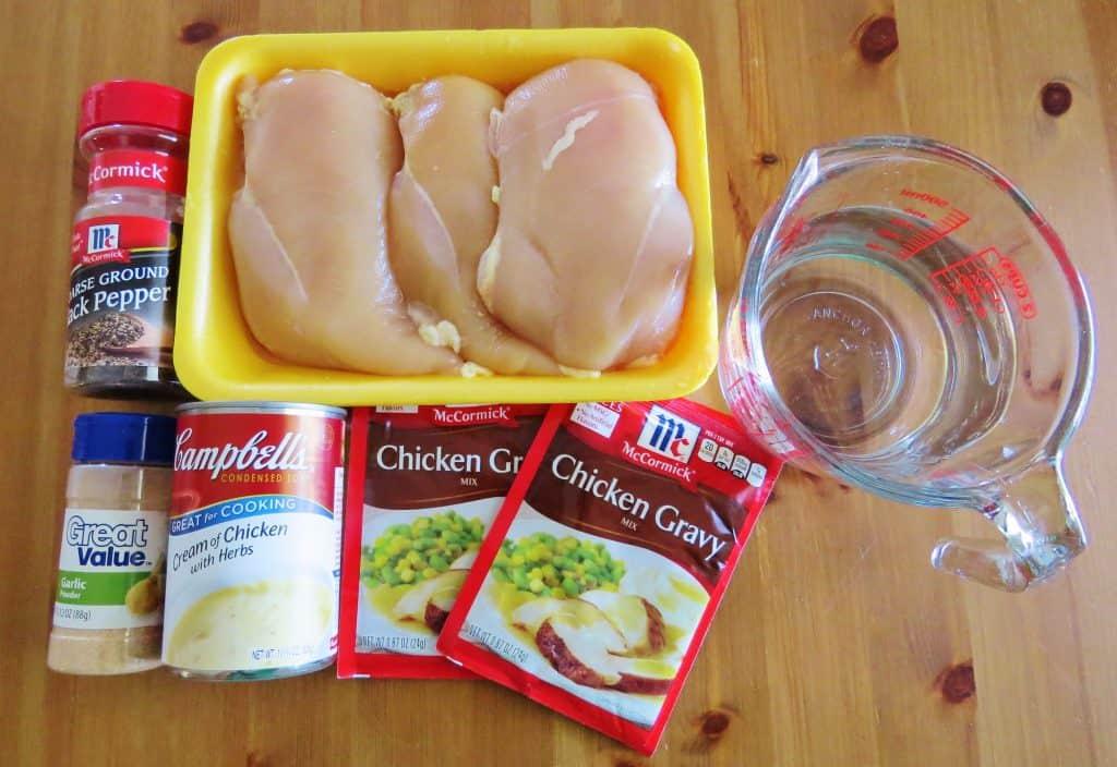 boneless, skinless chicken breasts, chicken gravy mix packets, cream of chicken soup, garlic powder, black pepper, water