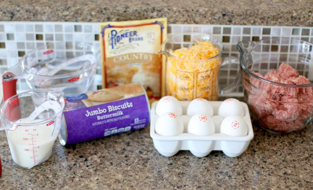 canned refrigerated biscuits, eggs, shredded cheddar cheese, packet gravy, ground sausage, milk