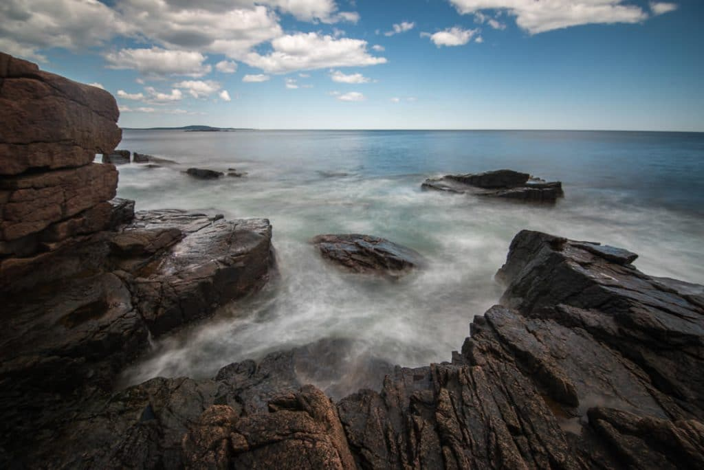 Ocean waves crashing over the rocks of the Great Head Trail in Acadia National Park