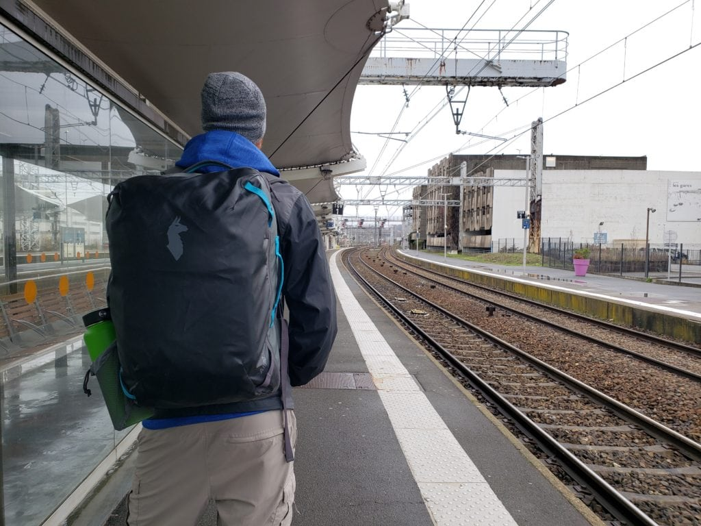 Buddy waiting for train in France during our long-term house sitting trip through Europe