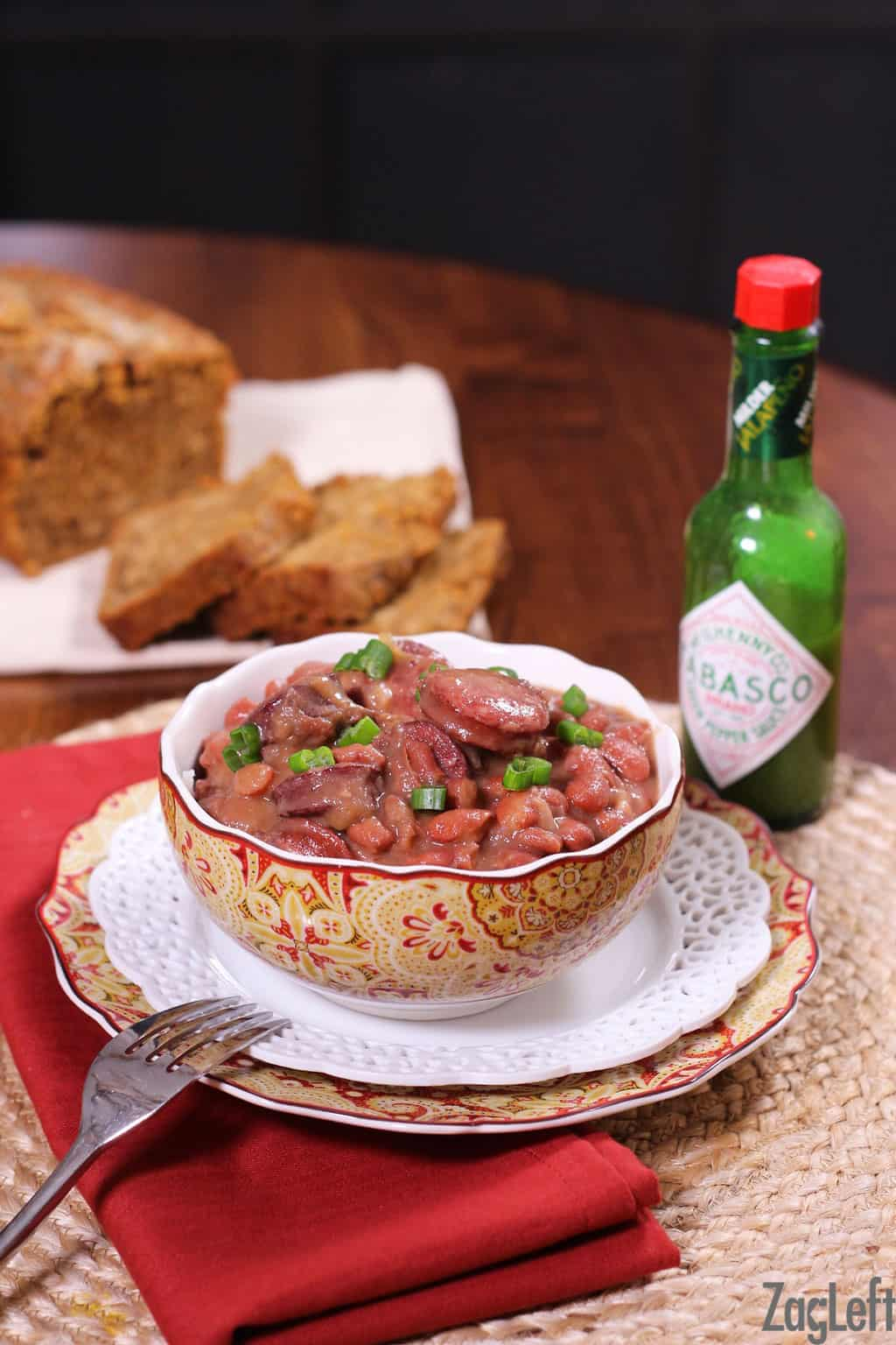 A classic New Orleans recipe for Red Beans and Rice made with a pound of red beans, spicy sausage, onions, garlic and green bell peppers. One of my family's favorite meals! www.zagleft.com