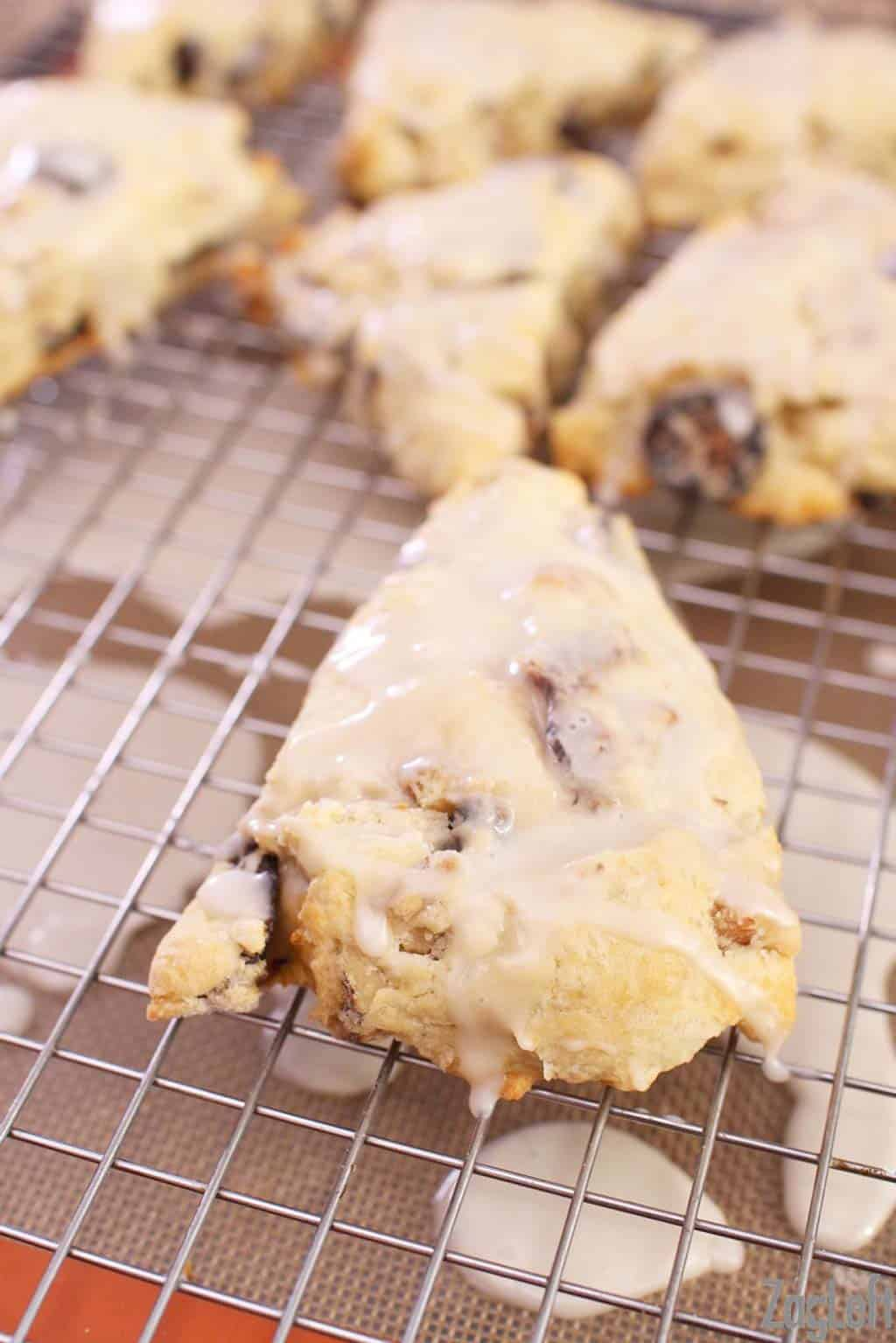 Closeup of Fig and Walnut Scones topped with a sweet Maple Glaze on a cooling rack