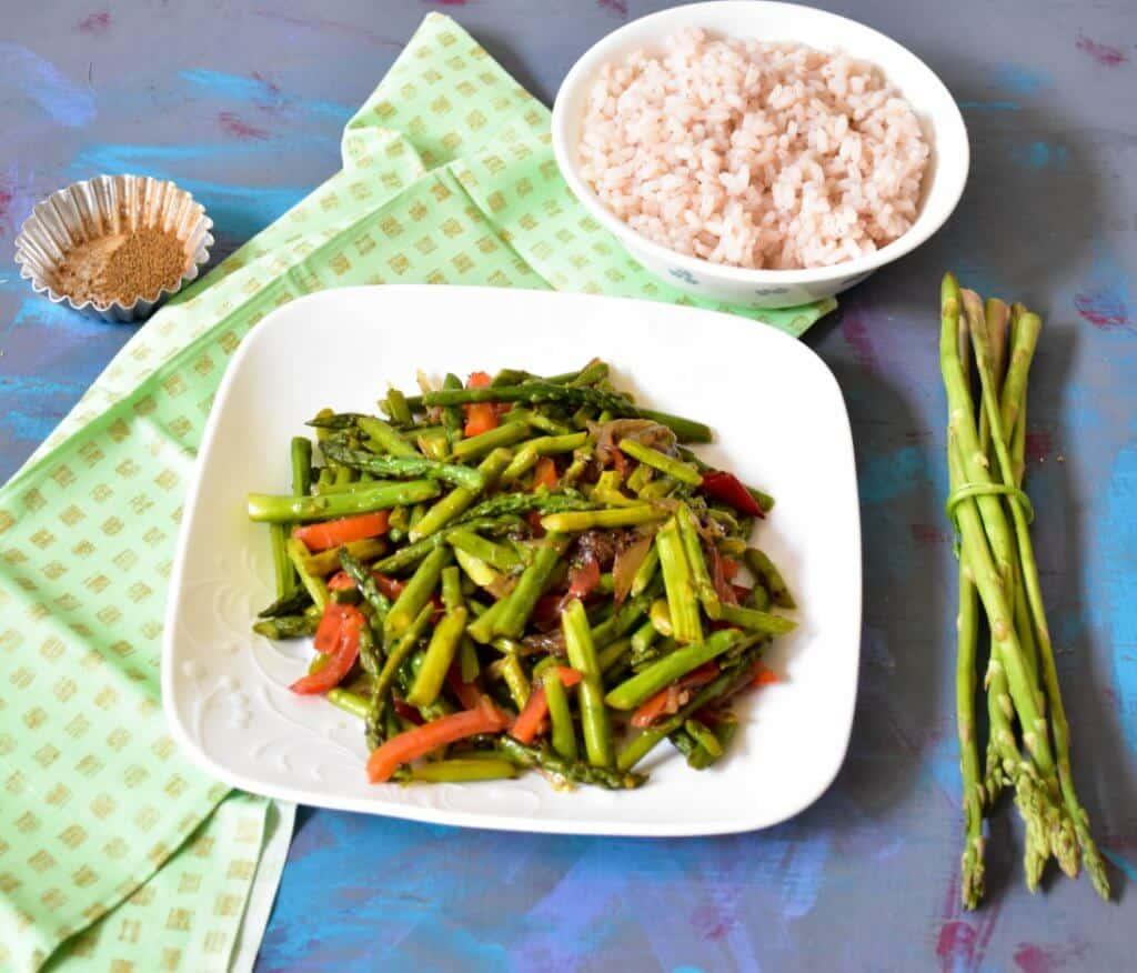 "<img src=""https://cdn.shortpixel.ai/client/q_glossy,ret_img,w_720,h_616/asparagus stir fry1.jpg"" alt=""Asparagus stir fry with mild spices1 >"