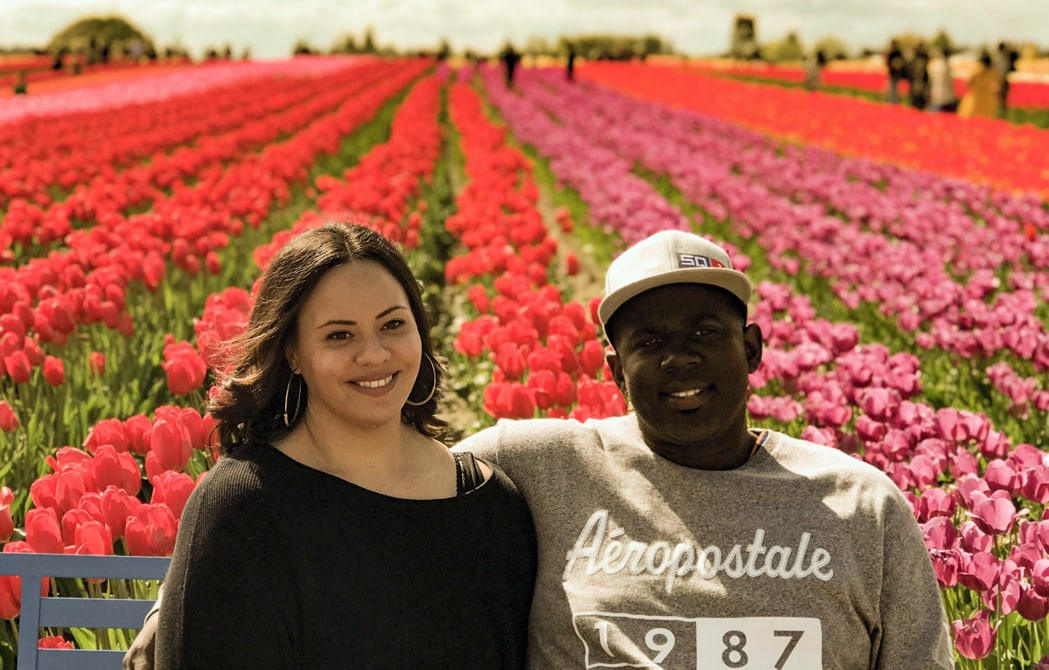 Chelsea Johnson with her husband in a field of flowers