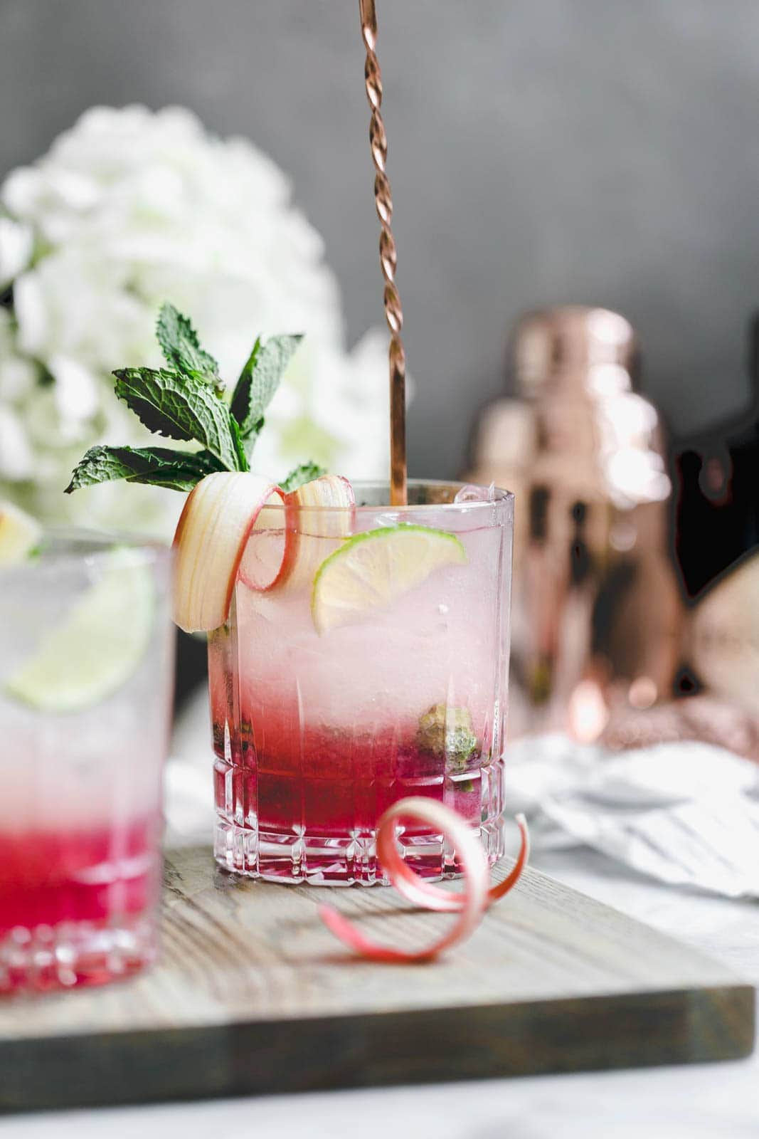 A thirst-quenching Rhubarb Mint Mojito made with rhubarb syrup, fresh mint, and lime. YUM.