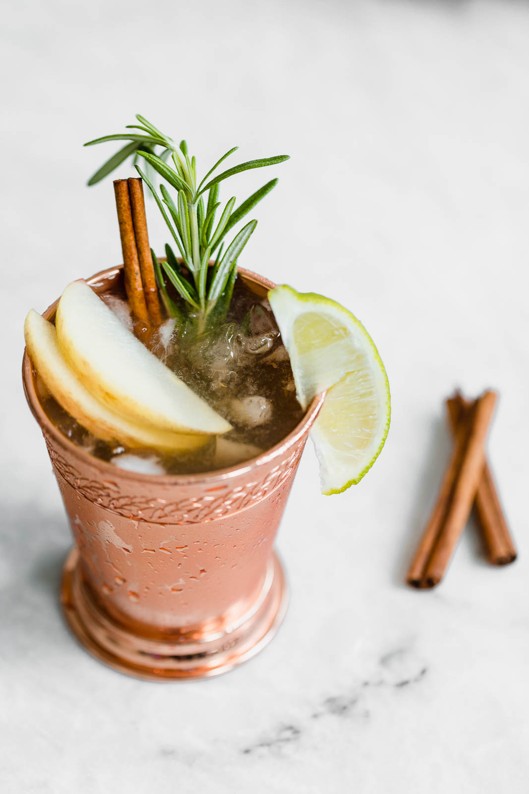 apple cider moscow mule with lime wedge