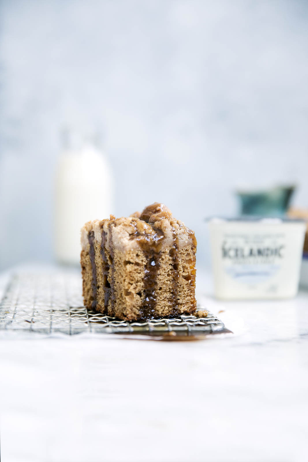 Perfectly spiced and super moist, this Icelandic skyr spice cake is topped with a ridiculously addicting crumb topping and toffee sauce!
