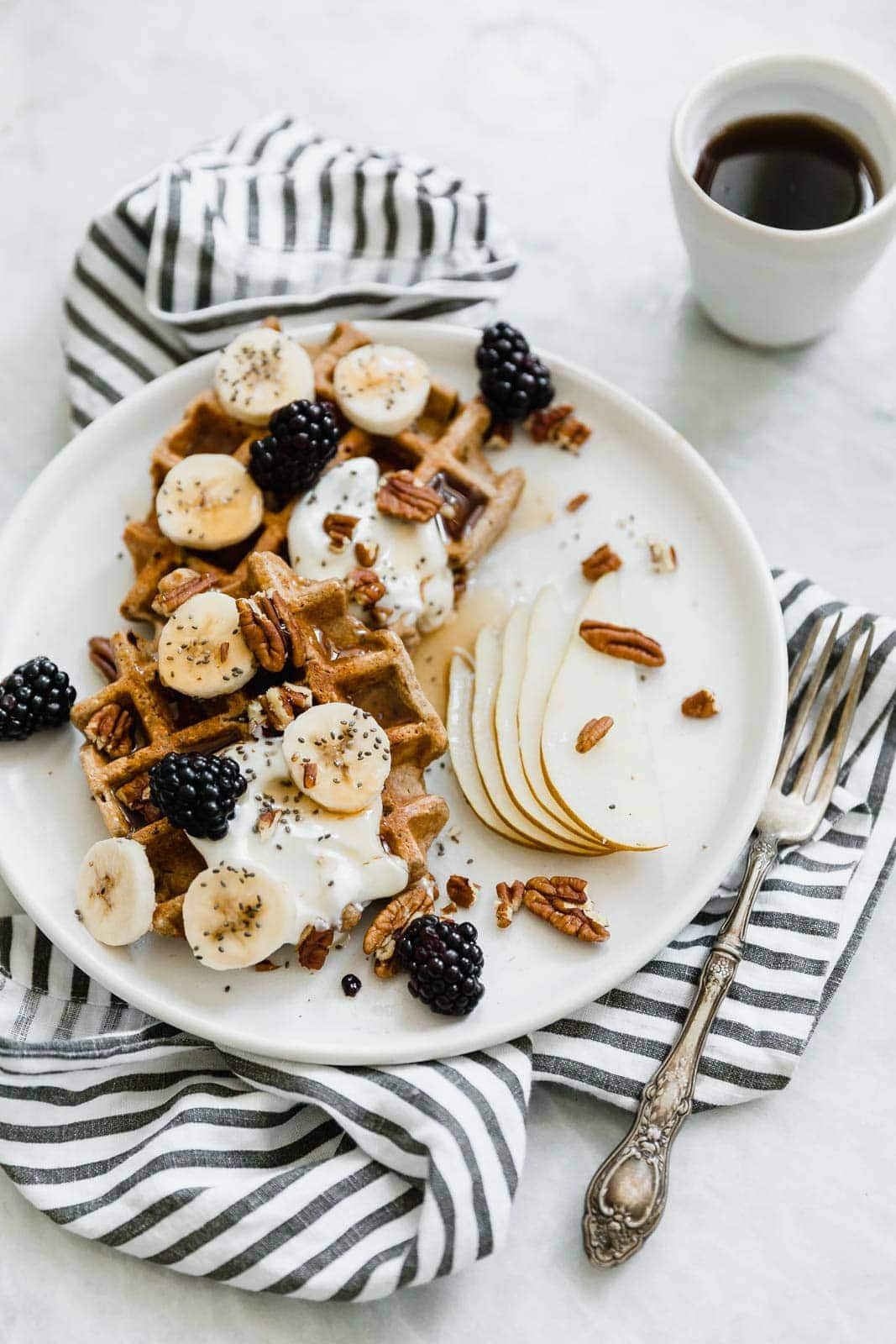 pumpkin spice waffles with fruit, nuts, and yogurt