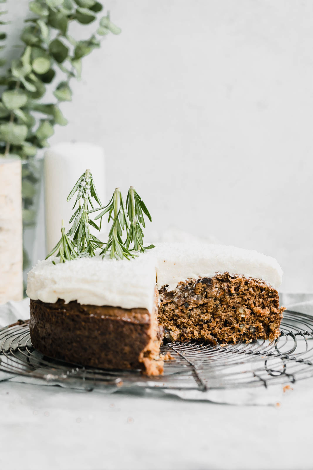 coconut carrot cake with cream cheese frosting on wire rack