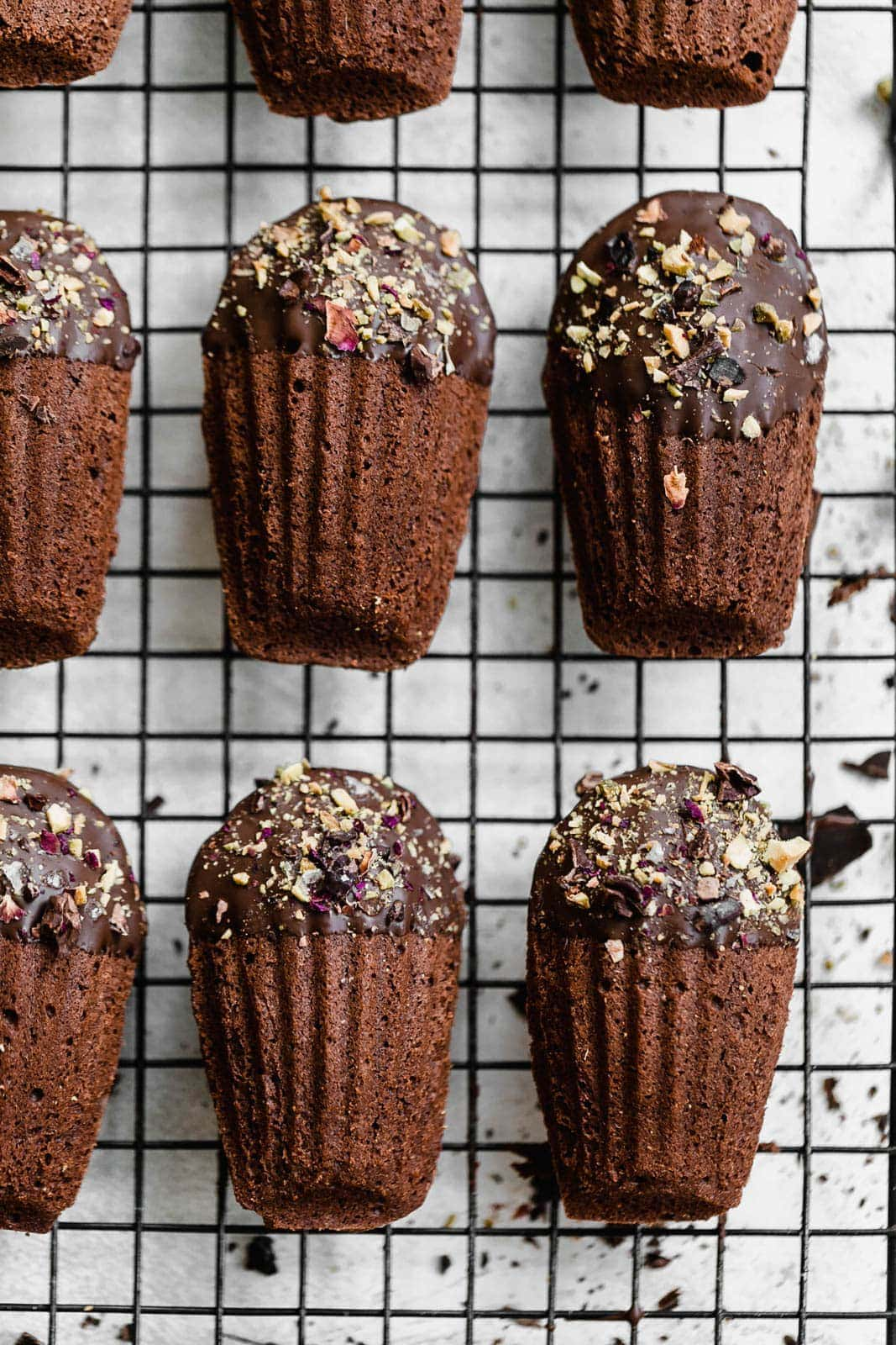 Chocolate-Dipped Chocolate Madeleines on wire rack