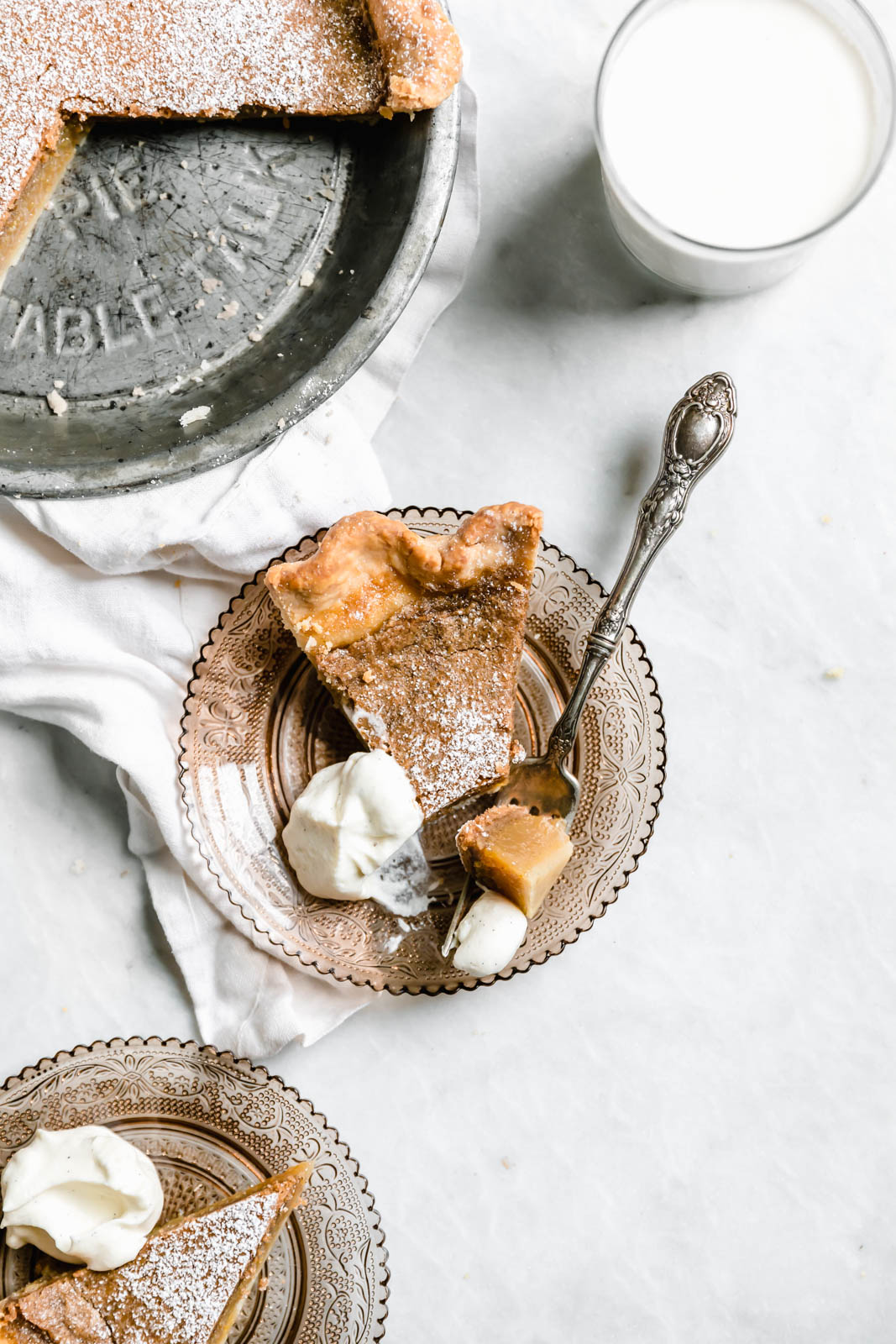 slice of Brown Butter Maple Chess Pie on glass plate