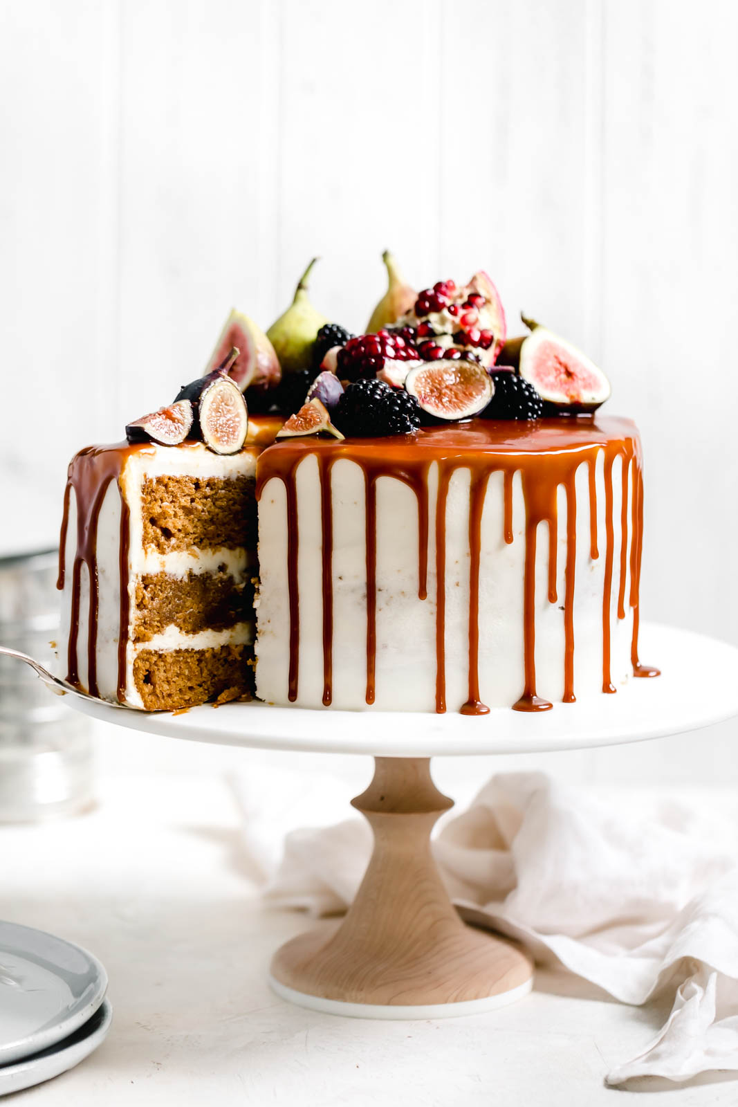 sliced Pumpkin cake on a cake stand