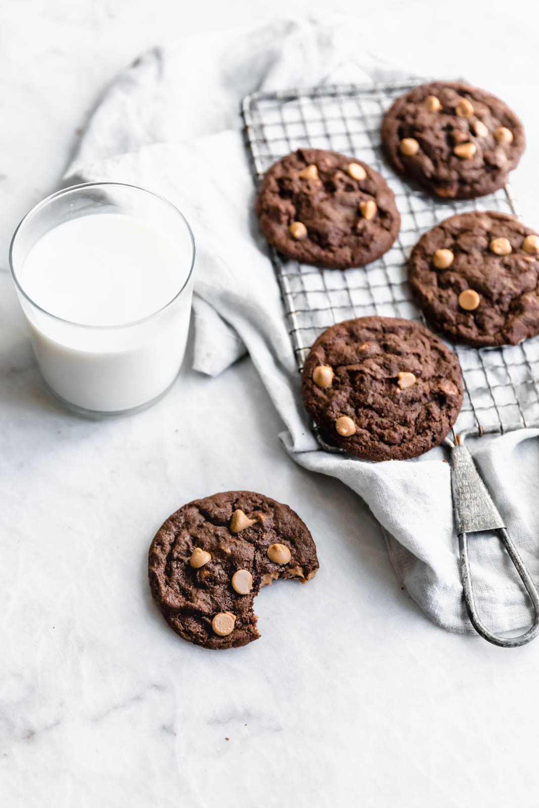 Chocolate Peanut Butter Chip Cookies next to glass of milk