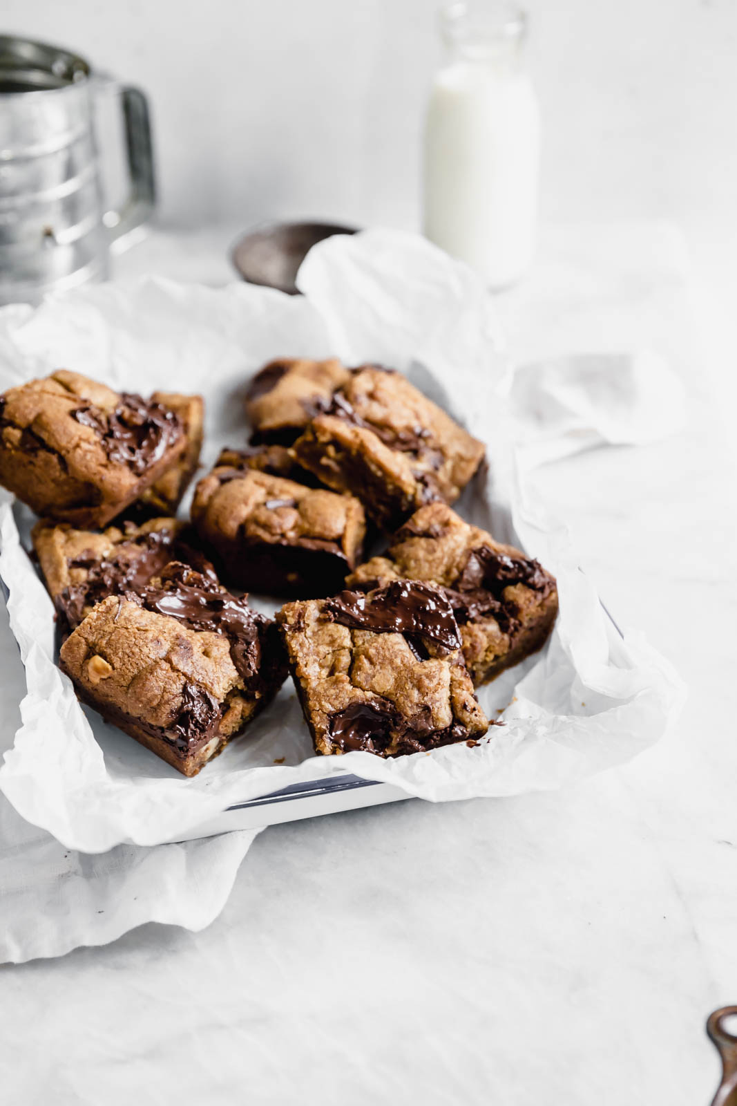 Brown Butter Nutella Chocolate Chip Cookie Bars with fat swirls of Nutella and lightly toasted hazelnuts.