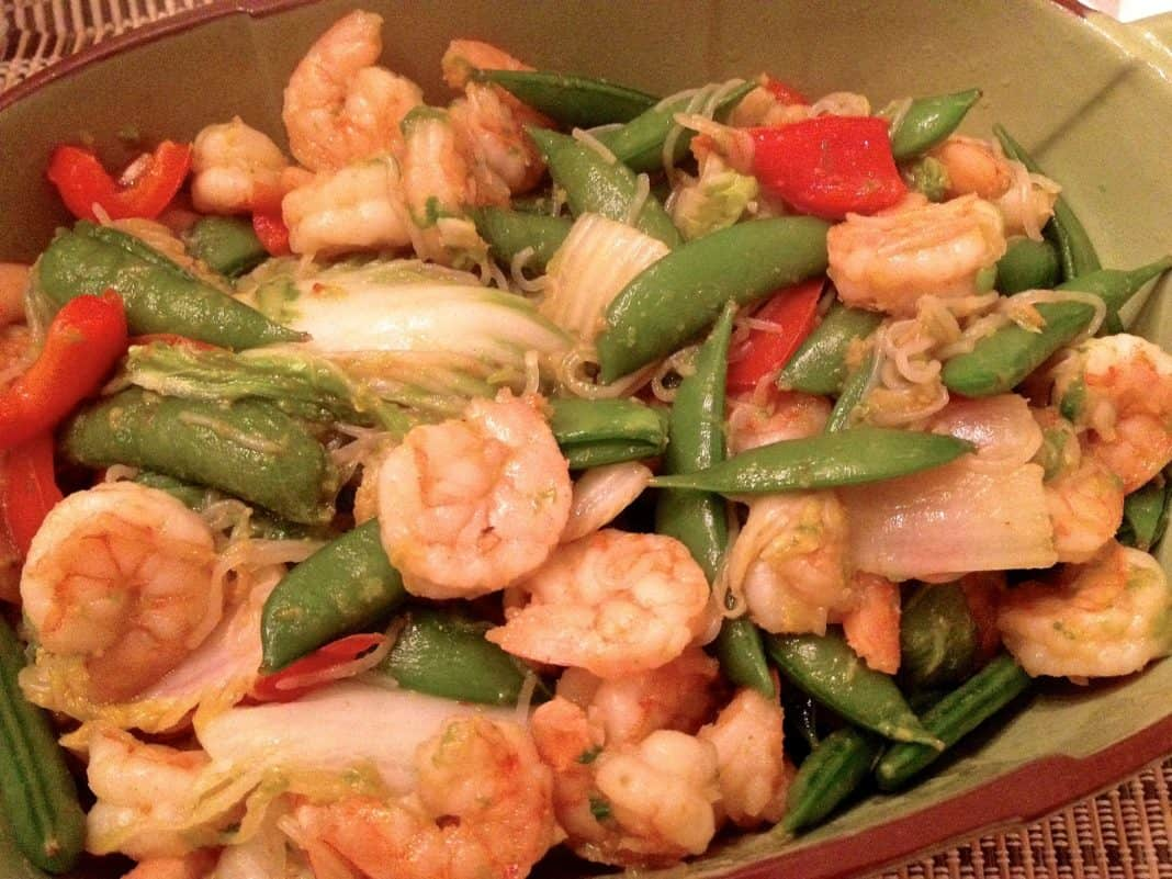 Shrimp, Bok Choy, Sriracha, snow peas, and Shirataki Noodles stir fry in a serving bowl