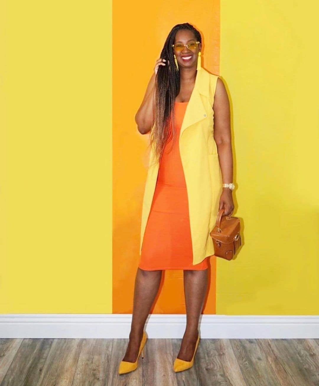 Tanasha wears a bright outfit of yellow and orange | 40plusstyle.com