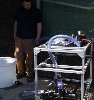 Pumping water in the parking lot (Em4 test).