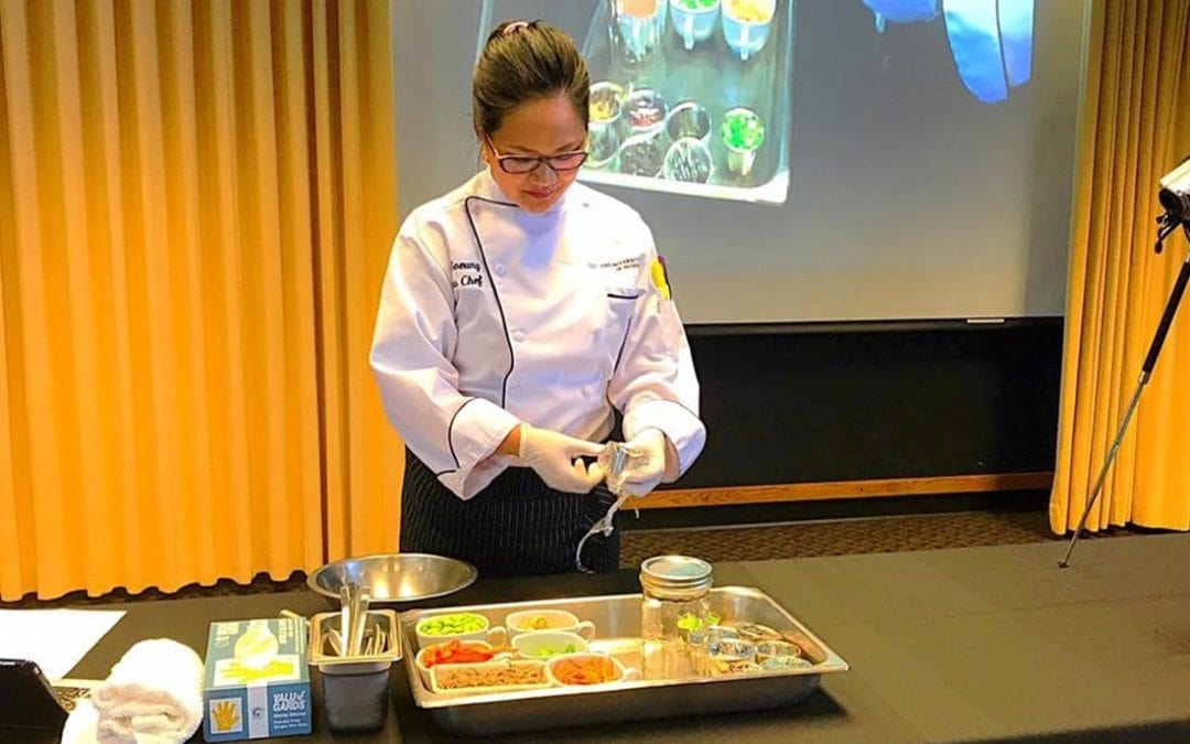 Jo Soeung demonstrating cooking at an event