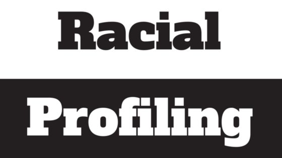 Black and white image says racial profiling