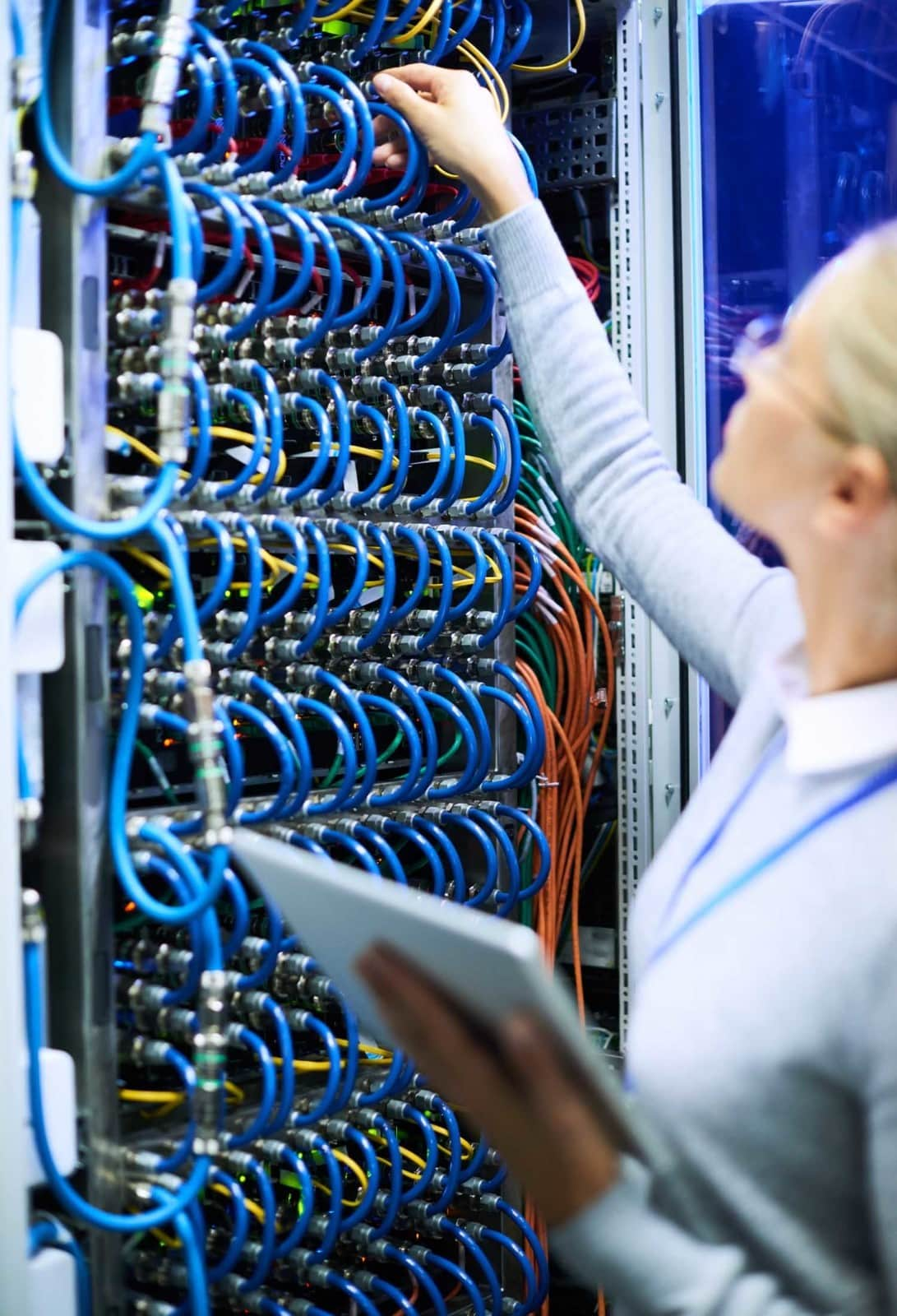 Woman adjusting server cables