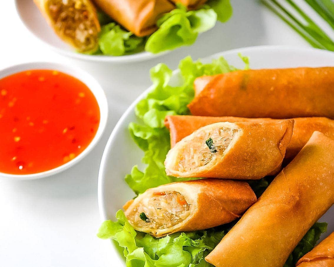 Plate of Thai spring rolls with sweet chili sauce