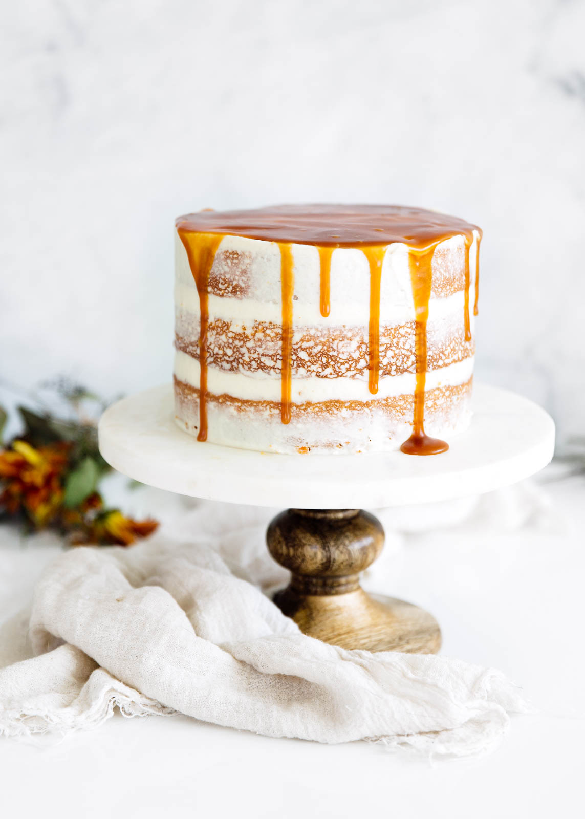 spiced carrot cake on a cake stand