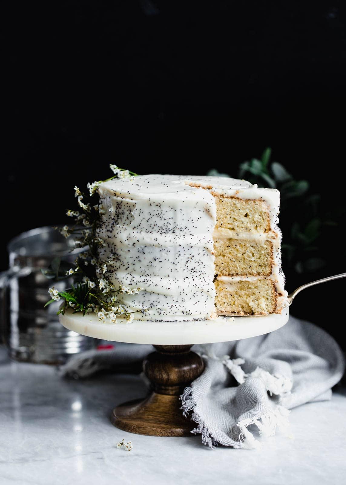 lemon poppy seed cake on cake stand