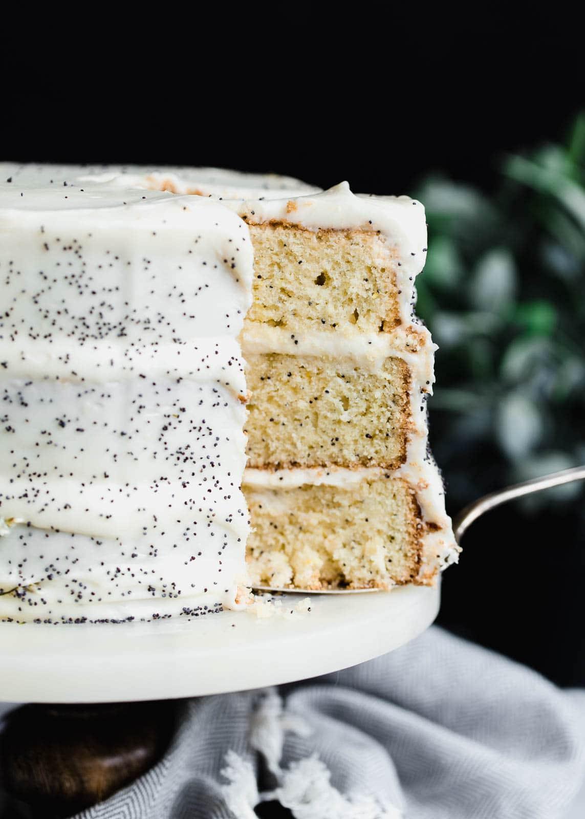lemon poppy seed cake being cut
