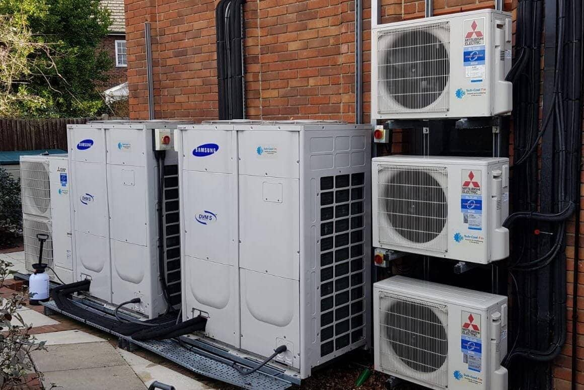 Large multiple exterior air conditioning units from Mitsubishi Electric and Samsung fitted by SubCoolFM neat pipework
