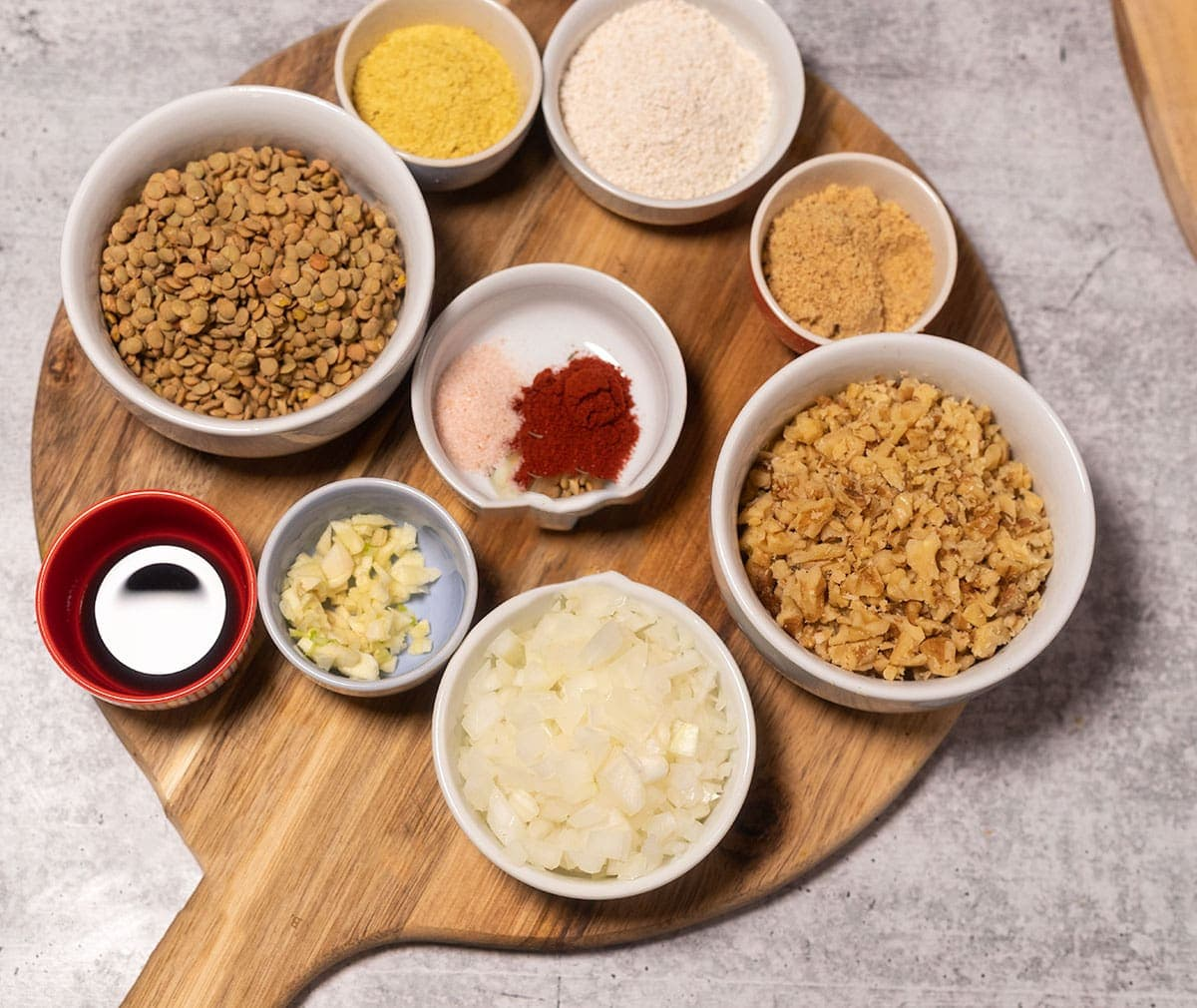ingredients for making lentil meatballs on a cutting board