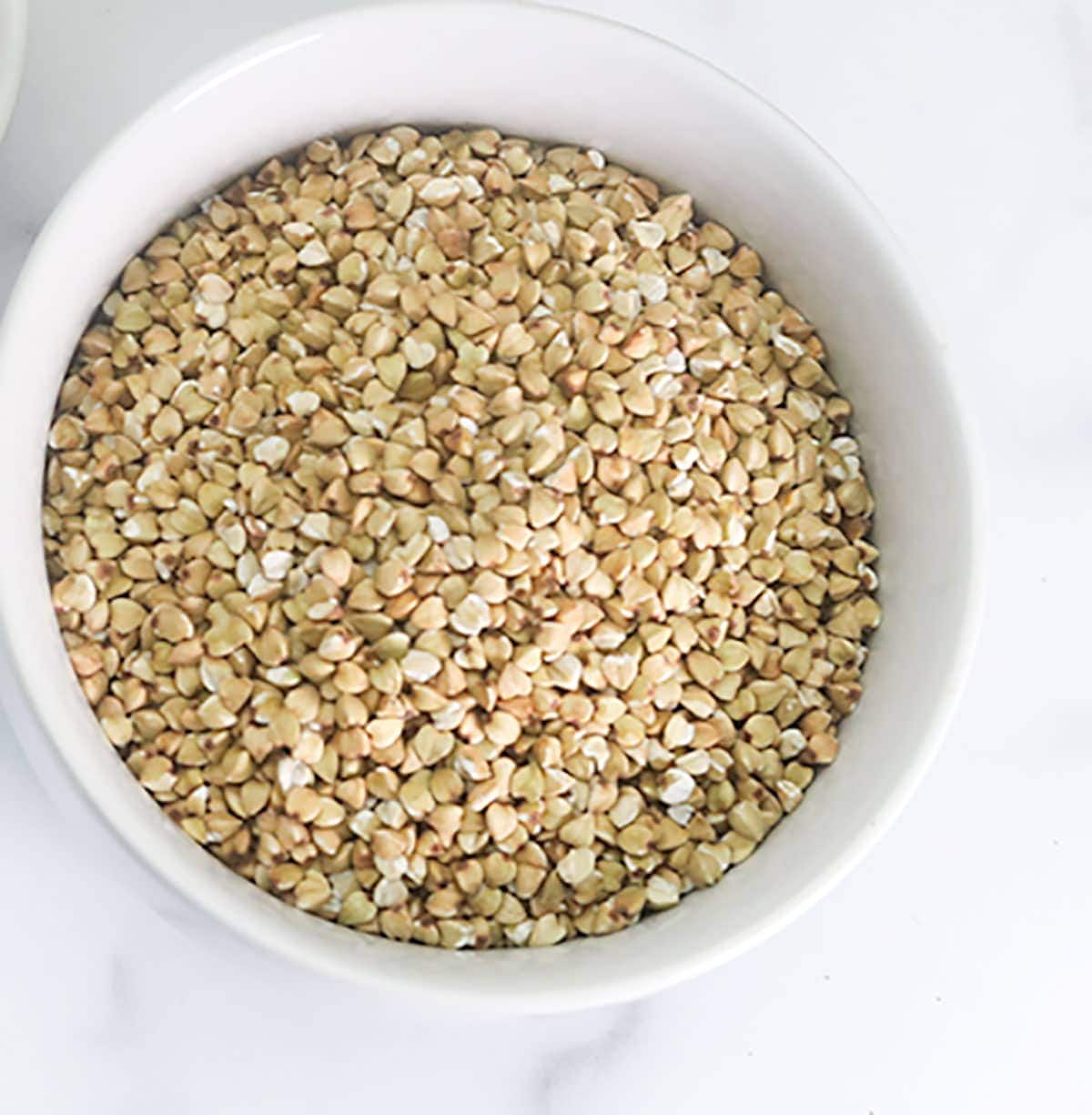 Close up image of buckwheat in a white bowl
