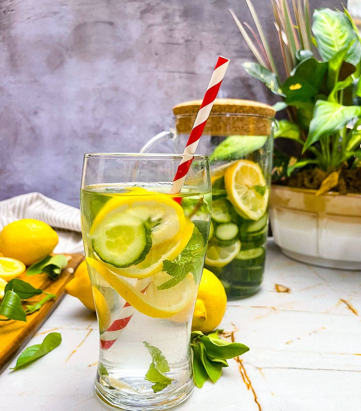 lemon cucumber water in glasses on a beige background