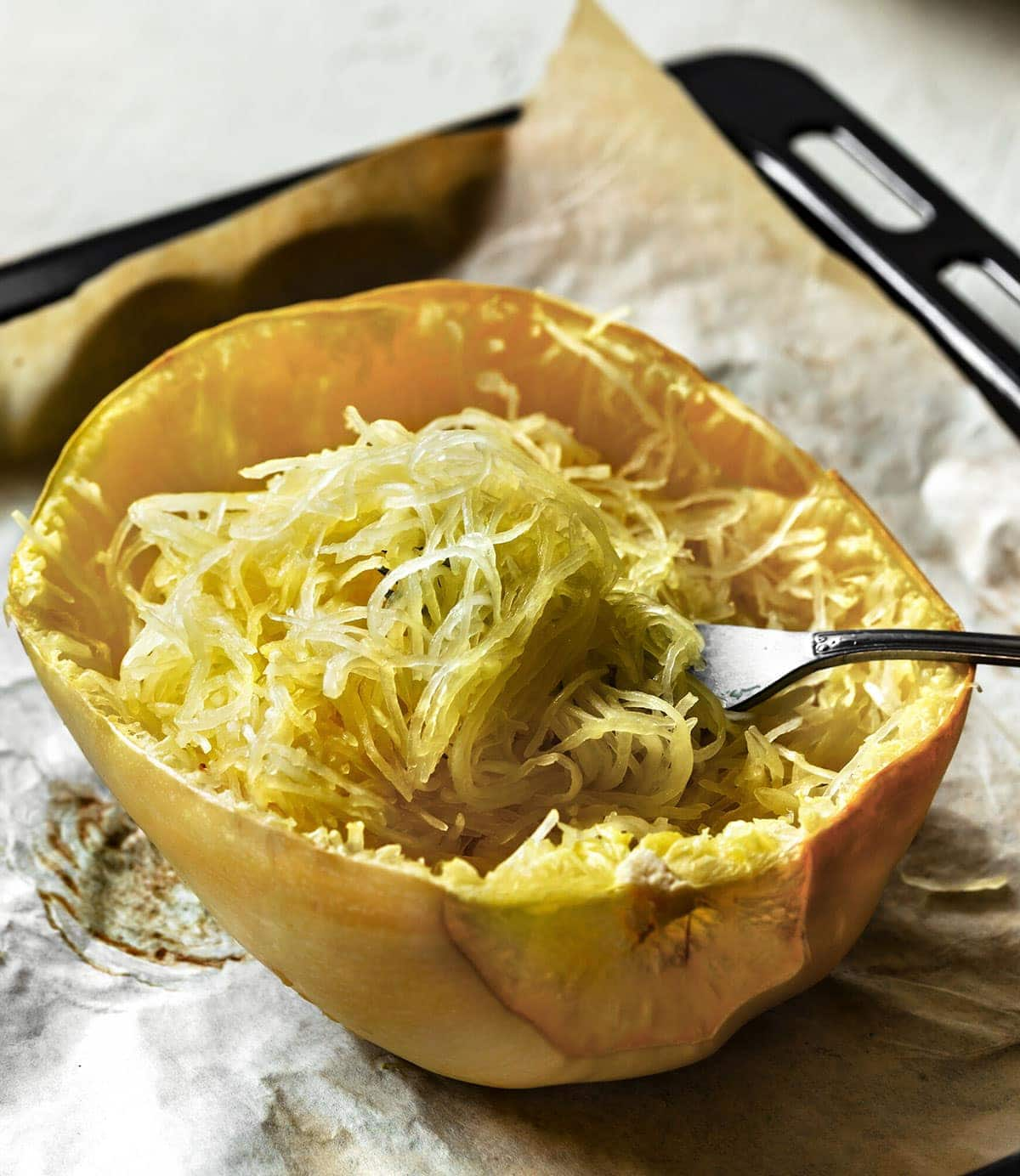 spaghetti squash baked on a tray